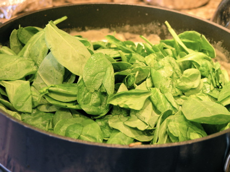 Throw the raw spinach right in the pan
