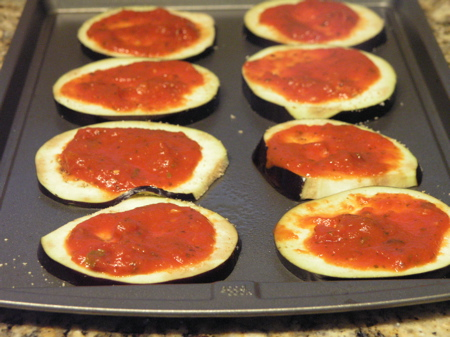 Eggplant slices with thin layer of sauce